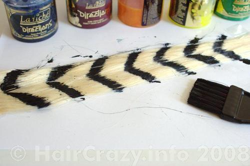 Painting on chevrons to form the raccoon tail
