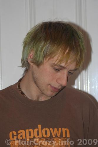 A combination of leftover colours has left Adam's hair a green mess.