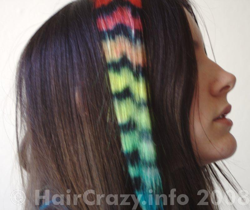 Coloured raccoon tails make a good contrast with dark hair