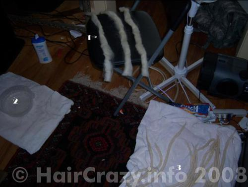 The workstation:  1.  raw wool roving, split into strips  2.  baking soda/hot water bath  3.  finished dreads.