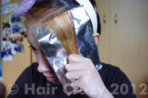 Tightly pull the hair down on the foil to hold it in place. At this point you can slide the comb out of the fold.