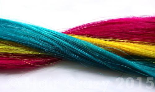 Turquoise, Yellow and Pink make up this triadic colour scheme